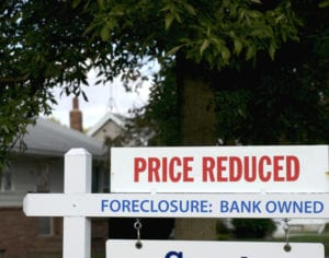 Foreclosed homes are owned by a delinquent taxpayer